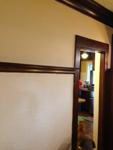 Two tone wall, darker on top, lighter below the picture shelf moulding.